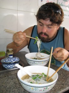 Adam enjoying a traditional Thai breakfast of spicy fishball noodle soup--fishballs are similar to meatballs, but made with white fish.  The texture can take a little getting used to, but the soup overall is so delish.