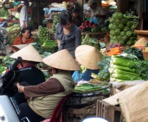 Vegetable sellers with conical hats in Dalat Market