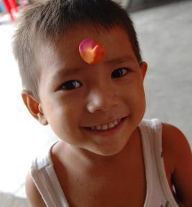 This little boy is new to the orphanage and was very timid when we first arrived, but once he came out of his shell, I could barely restrain myself from bringing him home with us.  (Also, that's clay on his head.  It was craft time :-))